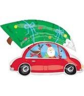 Weihnachtsmann mit Tannenbaum auf dem Autodach Folienballon